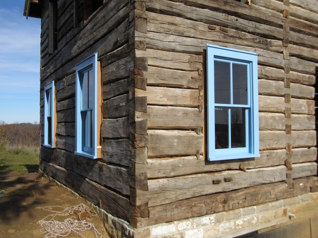 Siding a log house trout river log house for Windows for log homes