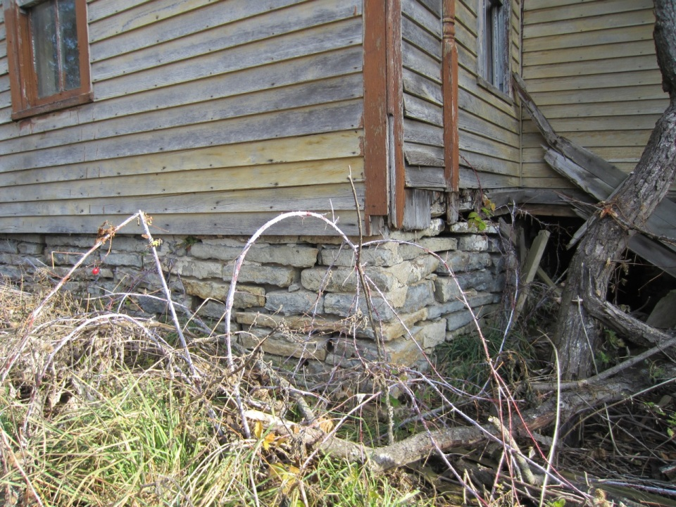 "The foundation of both the original log building and the subsequent additions were made with platville limestone, a variety about 5"" thick and very rot resistant."