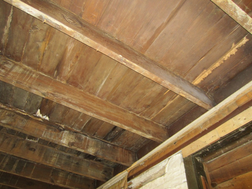 Exposed and hand planed joists and floor boards