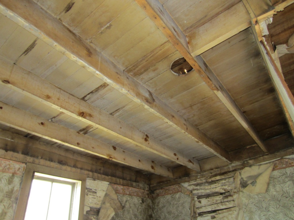 Exposed and painted joists and floor boards