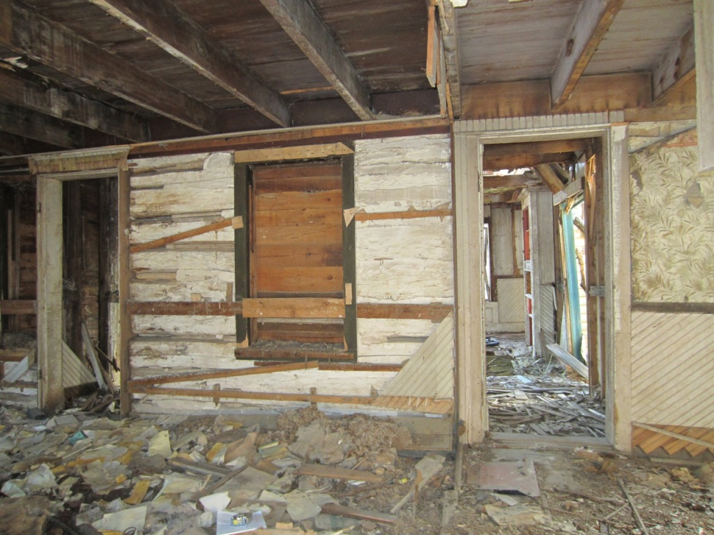 Looking south through original primary entrance to log house.  The left doorway was carved out of an orignal window and is a later addition.