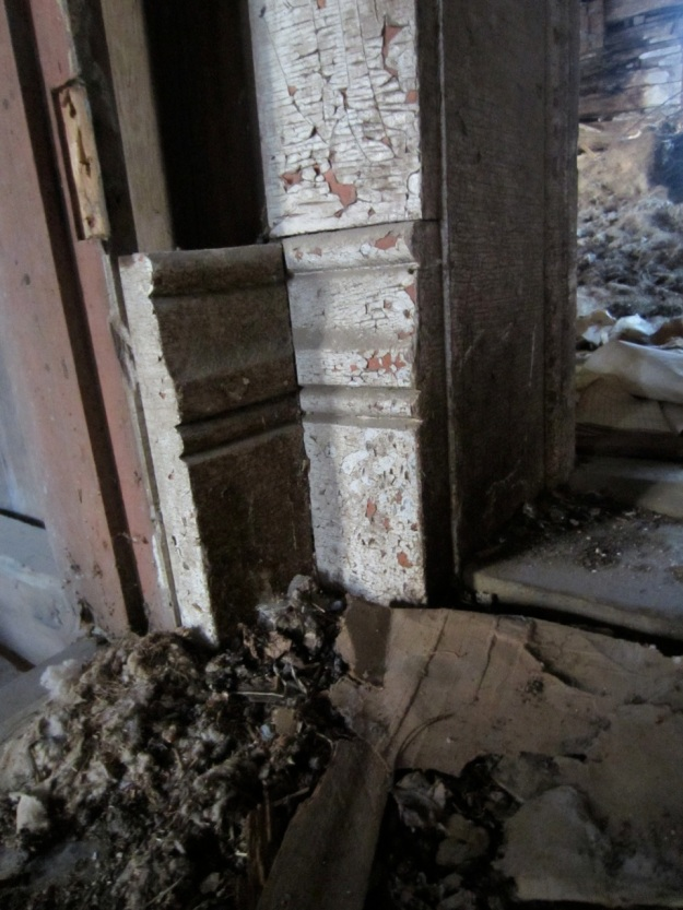 Most of the interior treatment has been removed, but a few pieces remain.  Shown here is a doorway plinth.