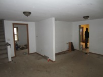Inside stue room, looking toward small room, staircase to left