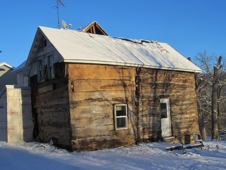 Three room house:  log addition left, original one room log house right